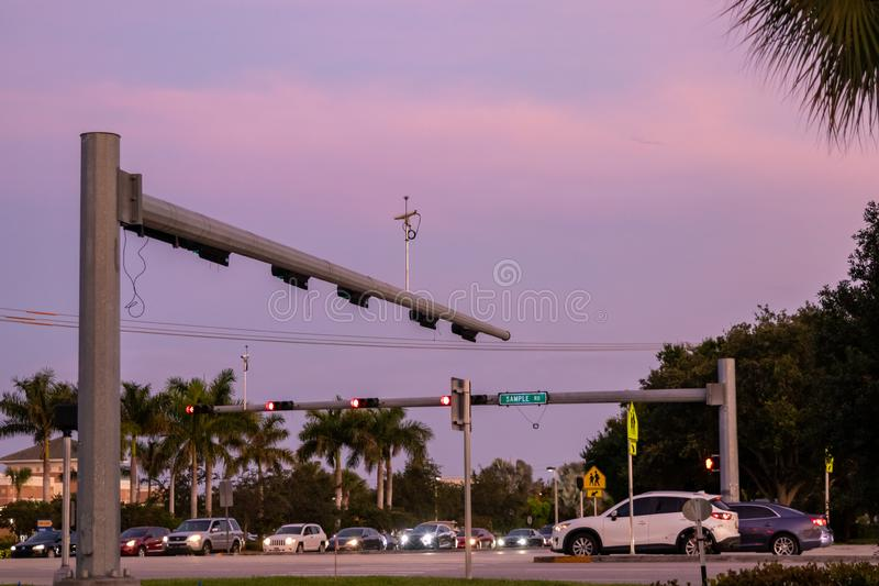 Roads intersection, cars stying on red light, beautiful sunset stock photography