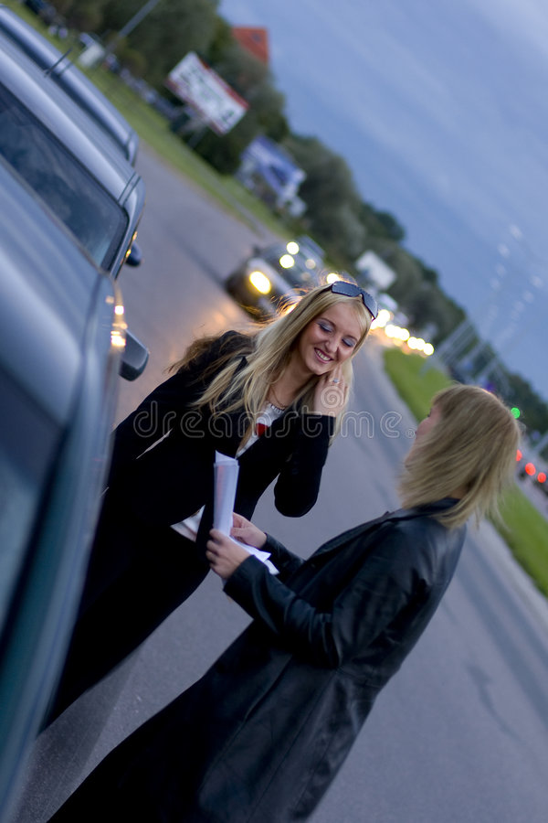 Roadside Business Discussion Stock Photography