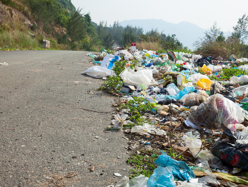Roadside dumping. Spontaneous garbage dump along the road in Vietnam royalty free stock photography