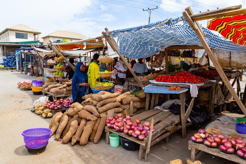 Roadside foods Lagos Nigeria; makeshift roadside stall. S selling foodstuff along Lekki Epe expressway in Lagos. Tomatoes, yam, lemon, onion, vegetables stock photo
