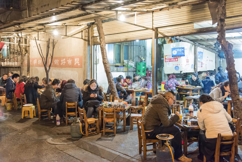 Roadside hotpot restaurant at night stock images