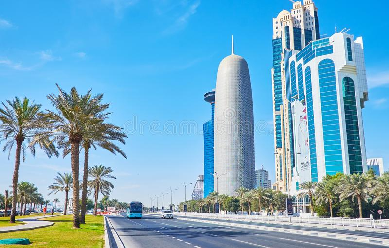 Roadside park in Doha, Qatar. DOHA, QATAR - FEBRUARY 13, 2018: The palms of Sheraton park stretch along the automobile road in Corniche street, separating royalty free stock images