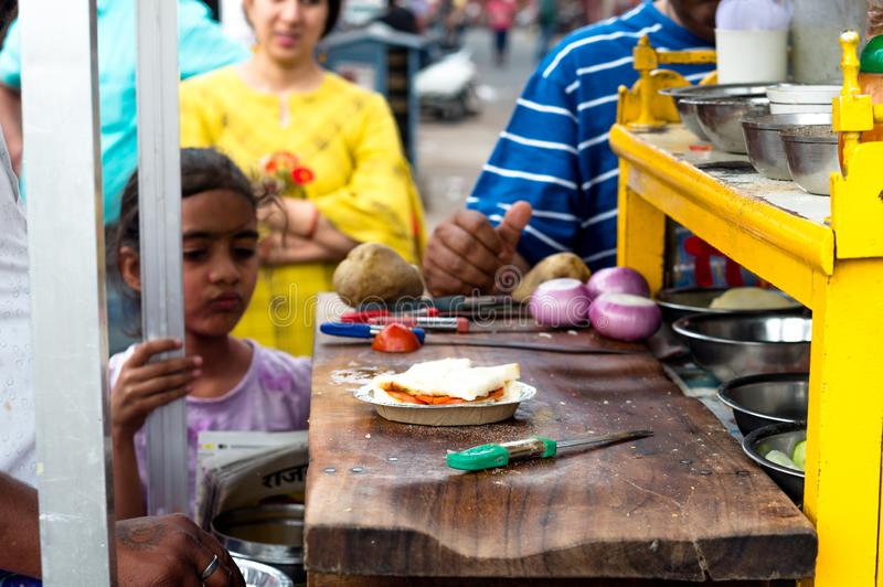 Roadside sandwich stall maker with children looking on royalty free stock images