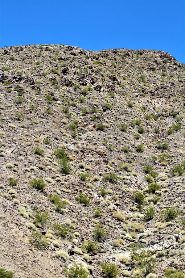 Scenic landscape view Phoenix to Las Vegas, Arizona, United States. Roadside scenic landscape view of vegetation, rocks and mountains on route US-93 north stock image