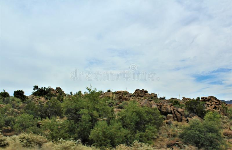 Scenic landscape view Las Vegas to Phoenix, Arizona, United States. Roadside scenic landscape view of vegetation, rocks and mountains on route US-93 south, Las royalty free stock image