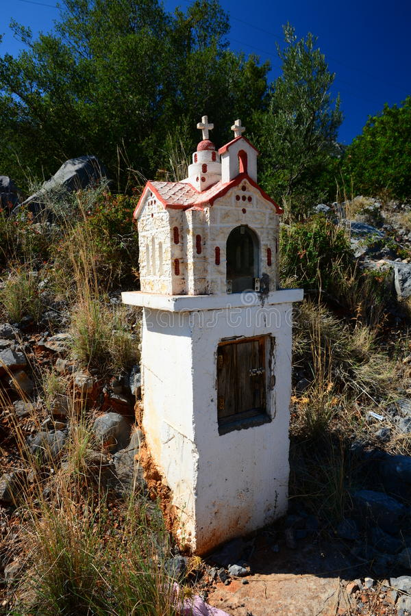 Roadside shrine, Greece. Traditional roadside shrine - small model of a church - in central Peloponnese, Greece royalty free stock photos