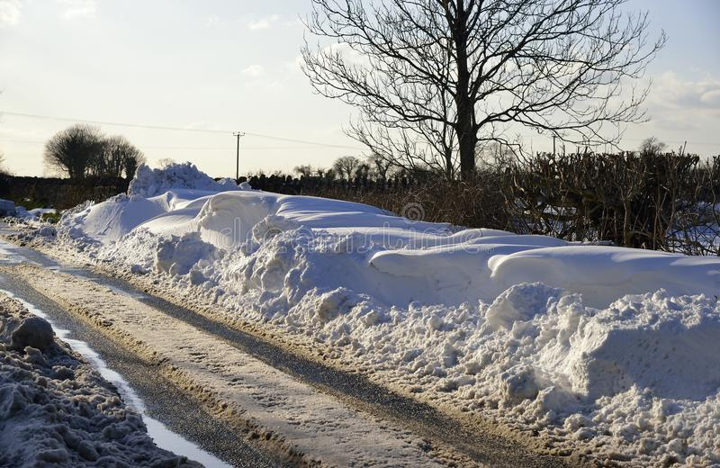 Roadside Snow Drifts. On Mendip Hills, Somerset March 2018 royalty free stock photo