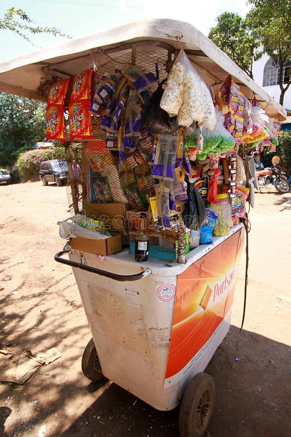 A roadside stall at a market in Accra, Ghana. A colorful portable, mobile, roadside stall at a market in Accra, Ghana selling sweets and snacks royalty free stock images