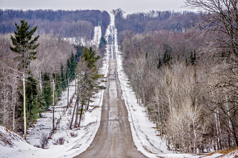 Roadside trees and farms in michigan during winter stock photography
