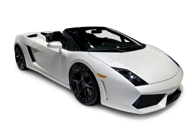 Roadster bianco con il percorso di residuo della potatura meccanica immagine stock