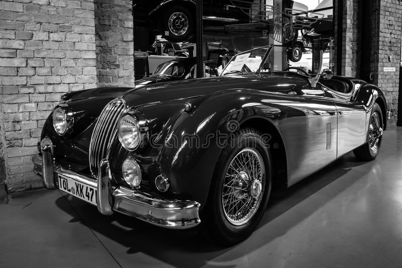 The roadster Jaguar XK140. BERLIN - MAY 10, 2015: The roadster Jaguar XK140. Black and white. 28th Berlin-Brandenburg Oldtimer Day royalty free stock photography