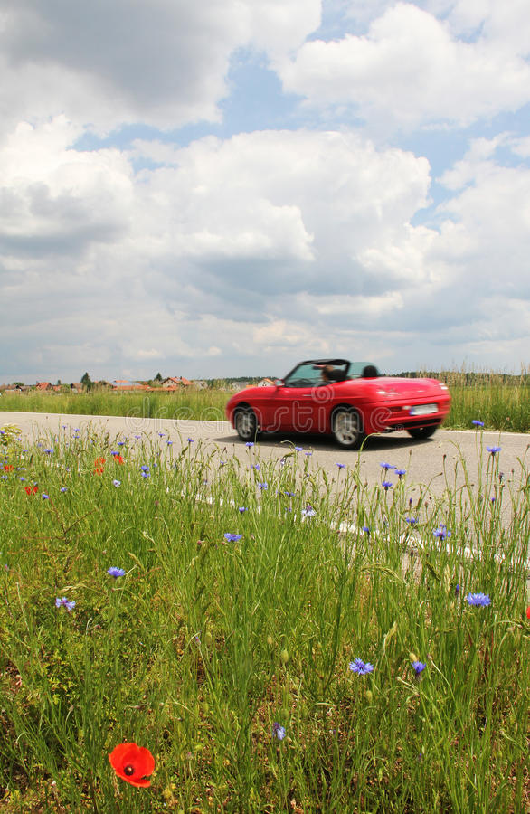 Roadster on the way, with overspeed. Roadster on the way with overspeed, country road royalty free stock photography