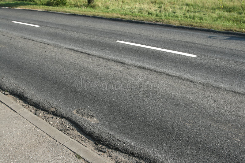 Roadway ruts. Roadway in really bad condition. Deep ruts in asphalt royalty free stock photos