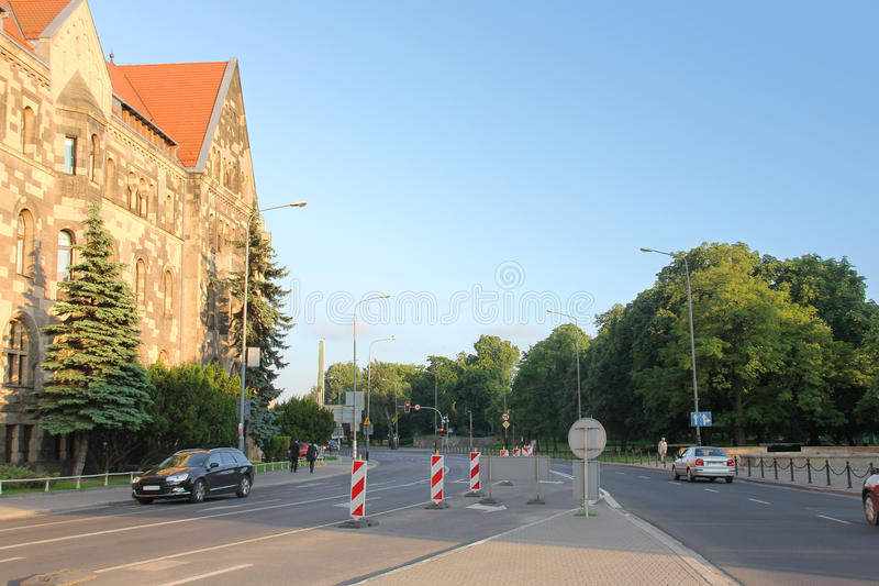 Download Roadway Street With Cars, Signs, Sidewalks, Trees And The Buildi Stock Photo - Image: 41910038