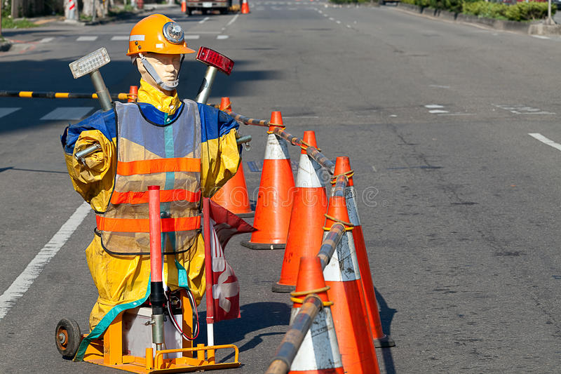 Roadwork. A person but not real stand on the road to alert person don't come close royalty free stock photo
