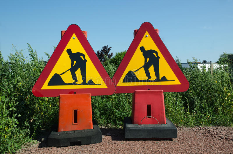 Roadwork traffic signs. Two roadwork traffic signs on the gound stock image