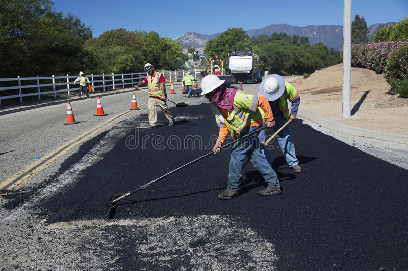 Roadworkers repaves road with steam, Encino Drive, Oak View, California, USA stock photography