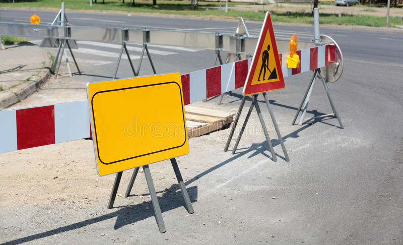 Roadworks. Road signs in a street under reconstruction stock images
