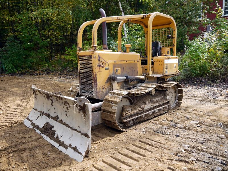 Roadworks: grader on building site stock photography