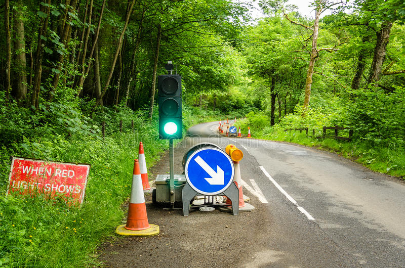 Roadworks Signs and Traffic Light stock images