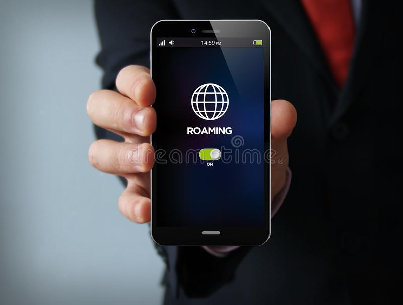 Roaming businessman smartphone. New technologies concept: businessman hand holding a 3d generated touch phone with roaming on the screen. Screen graphics are stock photos