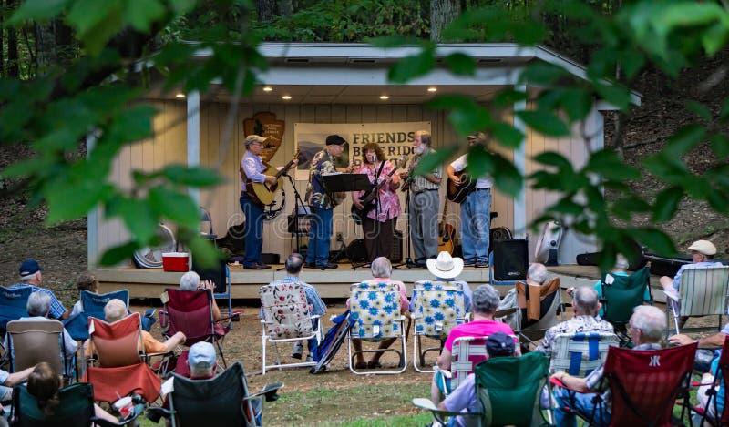 Virginia Carolina playing a Bluegrass Music. Roanoke County, VA, August 18th, 2019: Virginia Carolina playing Bluegrass Music at the Roanoke Mountain Picnic Area royalty free stock photos