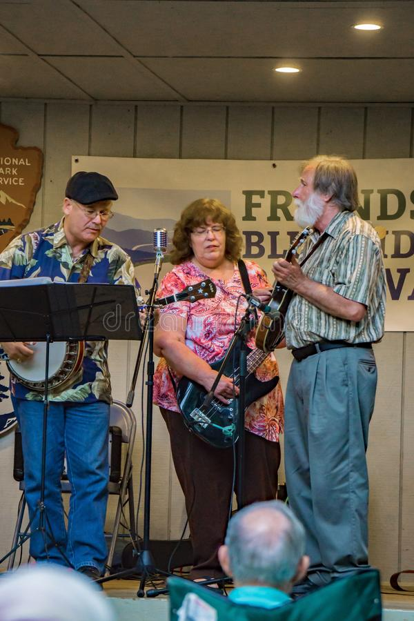 Virginia Carolina Singing and Playing Bluegrass Music. Roanoke County, VA, August 18th, 2019: Virginia Carolina playing Bluegrass Music at the Roanoke Mountain royalty free stock photography