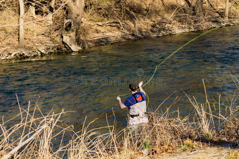 Fly Fisherman Making a Perfect Cast for Rainbow Trout on the Roanoke River, Virginia, USA stock image