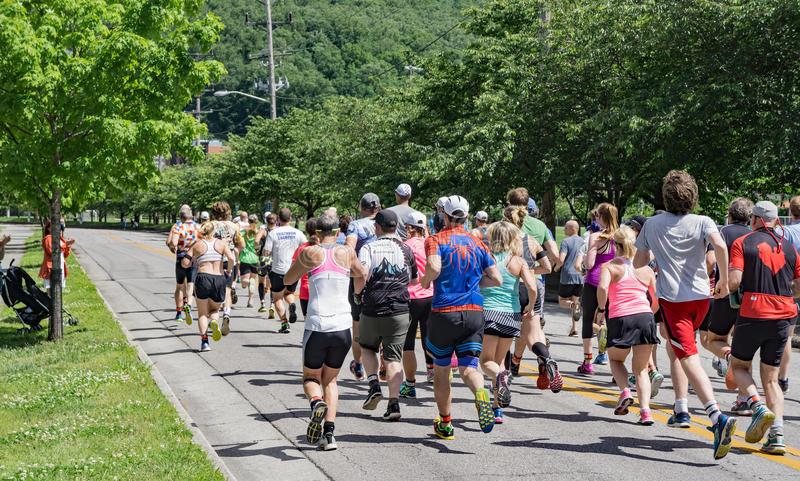 Roanoke Greenway Adventure Triathlon – Runners. Roanoke, VA – May 13th: Runners leave the starting line to competition in Roanoke Greenway royalty free stock photography