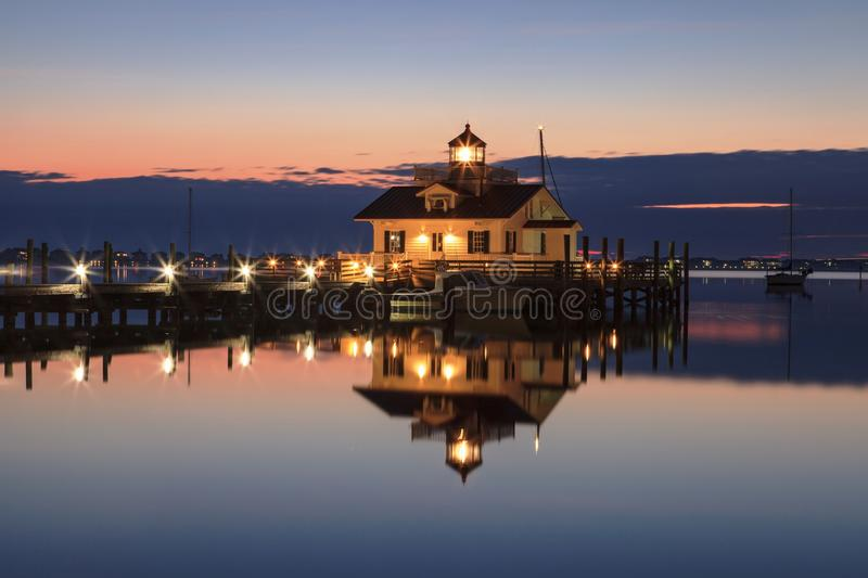 Roanoke Marshes Lighthouse North Carolina. The Roanoke Marshes Lighthouse illuminated at night on the quiet east end of the Manteo North Carolina waterfront royalty free stock photo