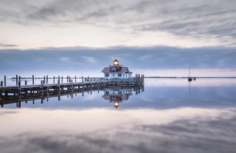 Roanoke Marshes Lighthouse Manteo North Carolina. In the stillness of a colorless morning, a beacon of light shines from the Roanoke Marshes Lighthouse on stock image