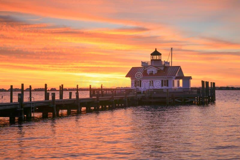 Manteo NC Sunrise Lighthouse Shallowbag Bay. Roanoke Marshes Lighthouse on the Manteo waterfront in North Carolina at sunrise stock images