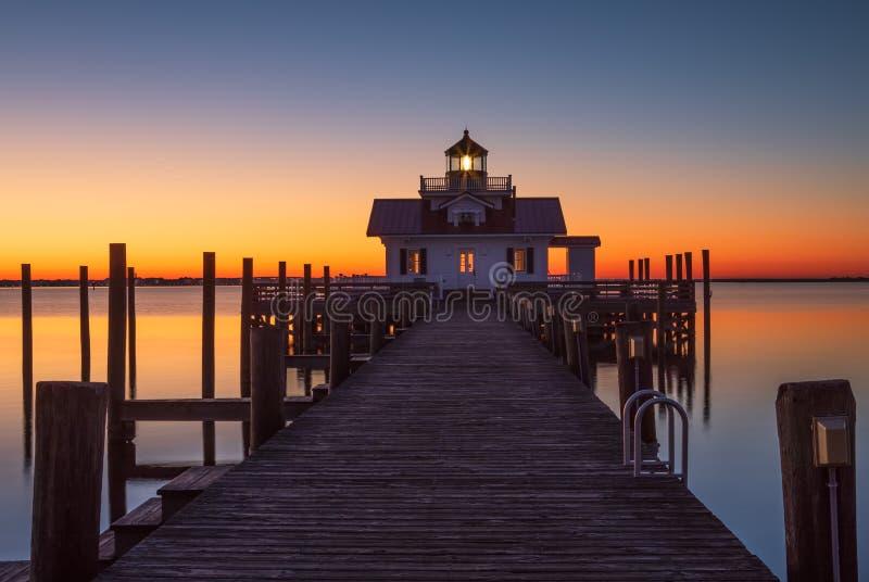 Sunrise over Lighthouse Shallowbag Bay Manteo North Carolina. Roanoke Marshes Lighthouse on Shallowbag Bay in Manteo, North Carolina at daybreak royalty free stock images