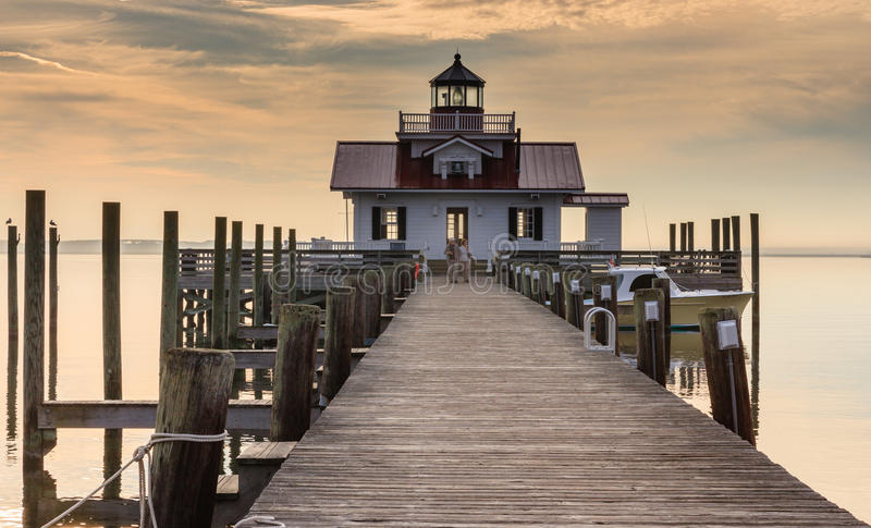 Roanoke Marshes Lighthouse. Roanoke Marshes is the smallest lighthouse on the Outer Banks, located at the end of a pier on Manteo waterfront. It serves as a stock photos