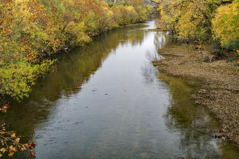 Roanoke River During Autumn Foliage. Autumn view of the Roanoke River flowing through the Roanoke Valley at the base of the Blue Ridge Mountains located in stock photos