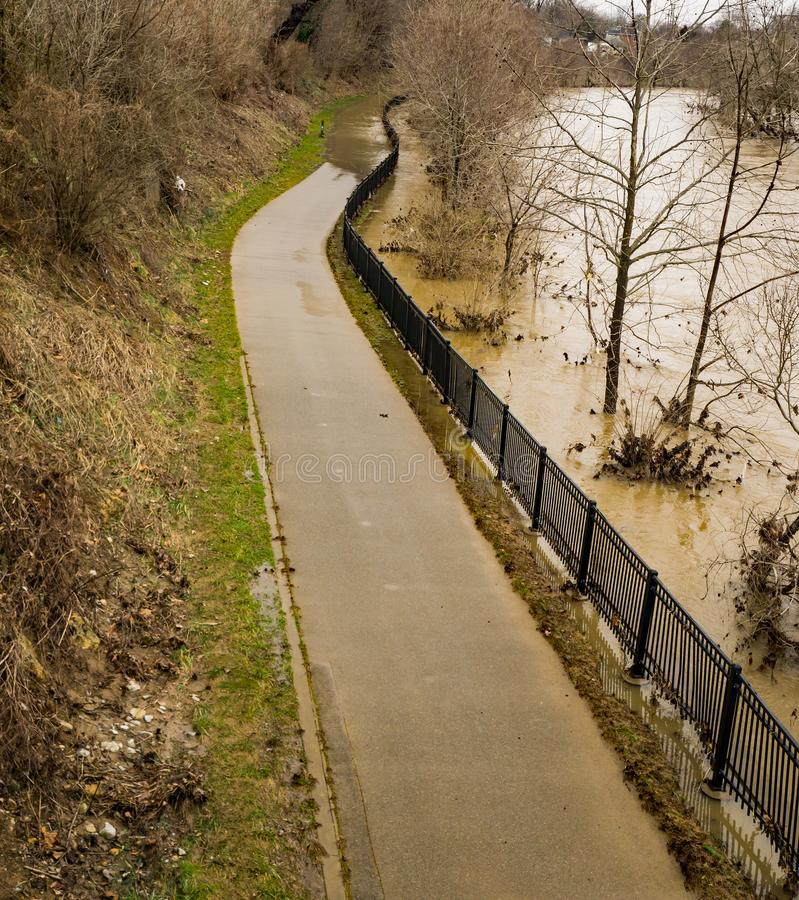 Roanoke River Covering the Roanoke River Greenway. February 24th, 2019: A winter view of the Roanoke River flooding the Roanoke River Greenway located in royalty free stock photo