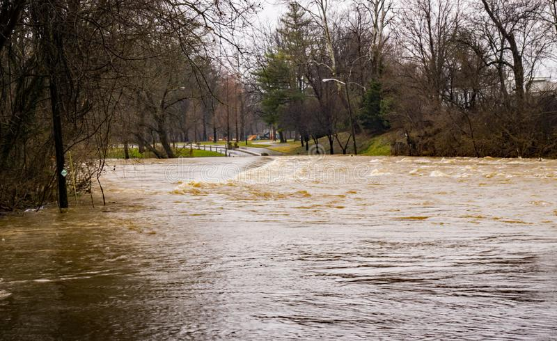 Flooding on the Roanoke River at Smith Park. Roanoke River at flood stage covering the low water bridge Park located in Smith Park Roanoke, Virginia, USA royalty free stock photo
