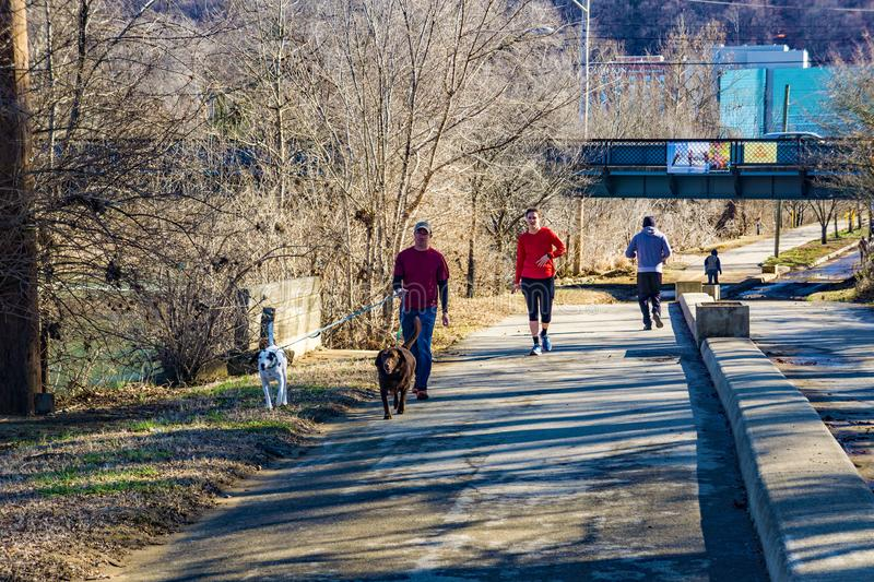 Early Morning Walkers, Runners, Joggers and Dog Walker on the Roanoke River Greenway royalty free stock photos
