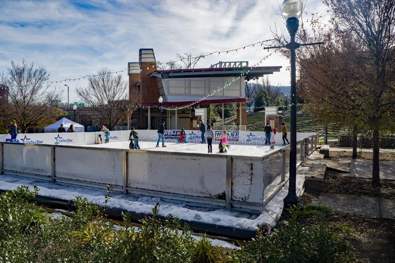 Families Enjoying a Day of Ice Skating stock photography