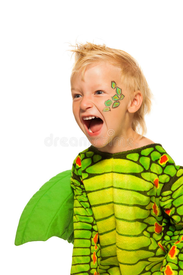 Roaring boy in monster dragon costume. Roaring boy in costume of dragon and stage makeup painted scale on his cheek scream standing isolated on white royalty free stock photos