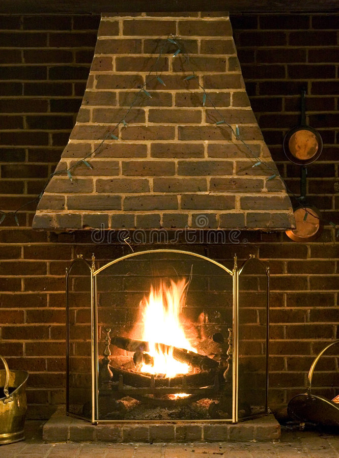 Roaring log fire of old English house royalty free stock images