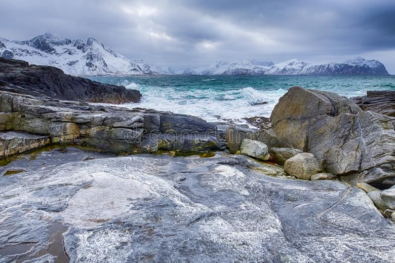 Roaring Ocean Near Rocky Shore of Picturesque Lofoten Islands in Norway at Spring. Horizontal Image stock photography