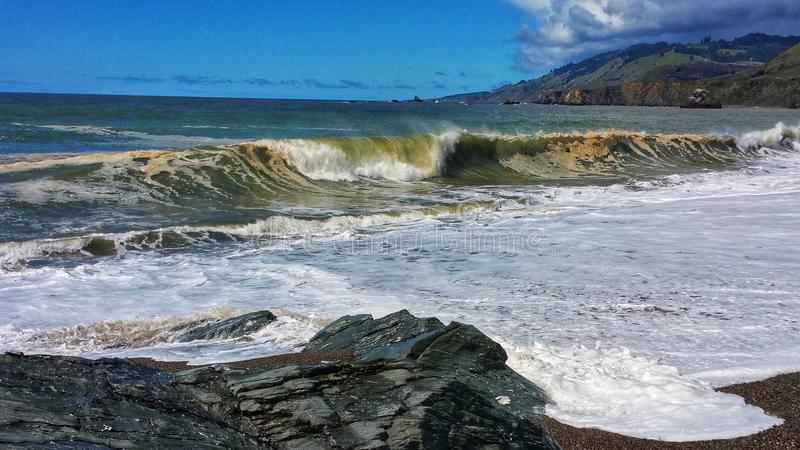 Roaring Waves - Craggy Boulders royalty free stock images
