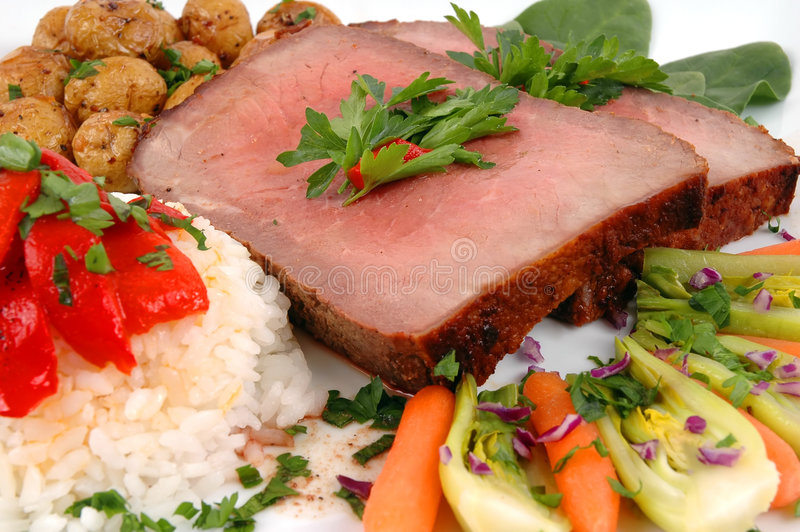 Roast Beef. Rice, organic vegetables and baby potatoes roasted with garlic and rosemary stock image