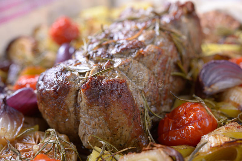 Roast beef. With baked vegetables. Shallow DOF royalty free stock image