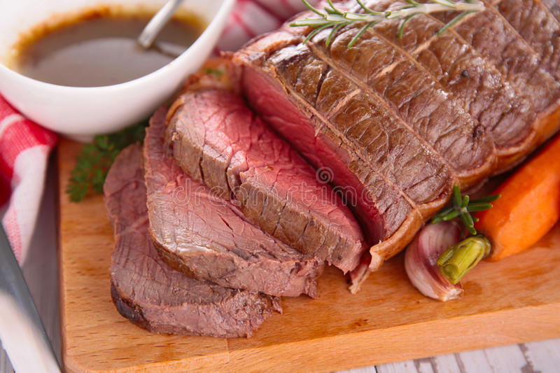 Roast beef on board. Cooked roast beef on board stock images