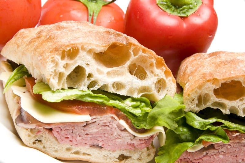 Roast beef boursin cheese ciabatta bread sandwich royalty free stock photo