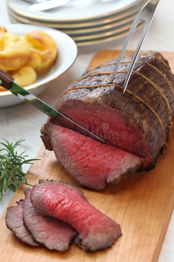 Roast beef carving. Sunday dinner royalty free stock image