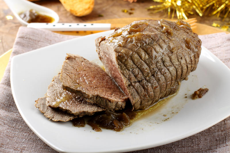 Roast beef with gravy. On Christmas background stock photos