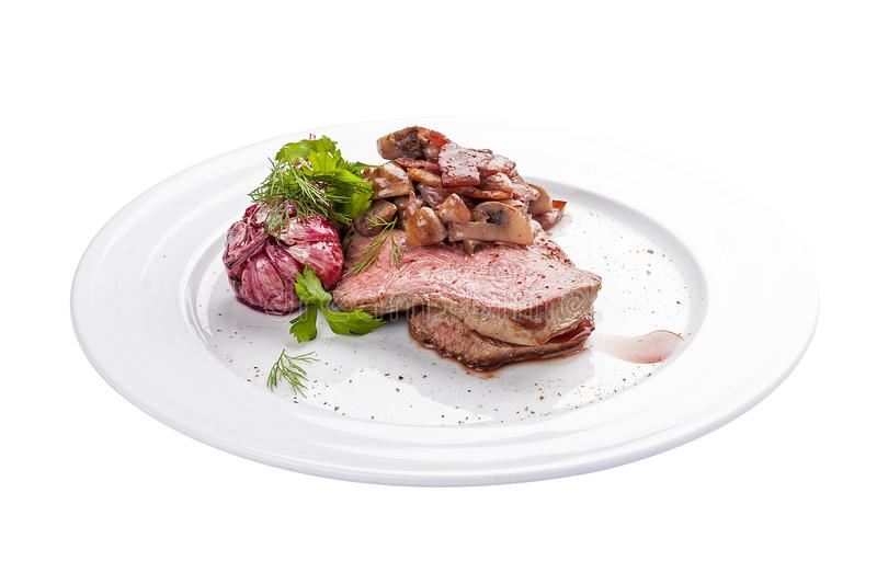 Roast beef with mushrooms and garlic. A traditional Spanish dish. stock photo